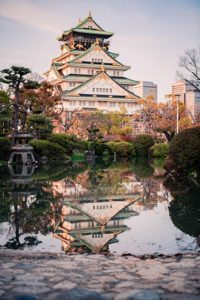 A Japanese Castle rests in the background reflected in the pool of water in front of it. Intended to be clicked to provide money to a paypal account.  Photo by Satoshi Hirayama from Pexels