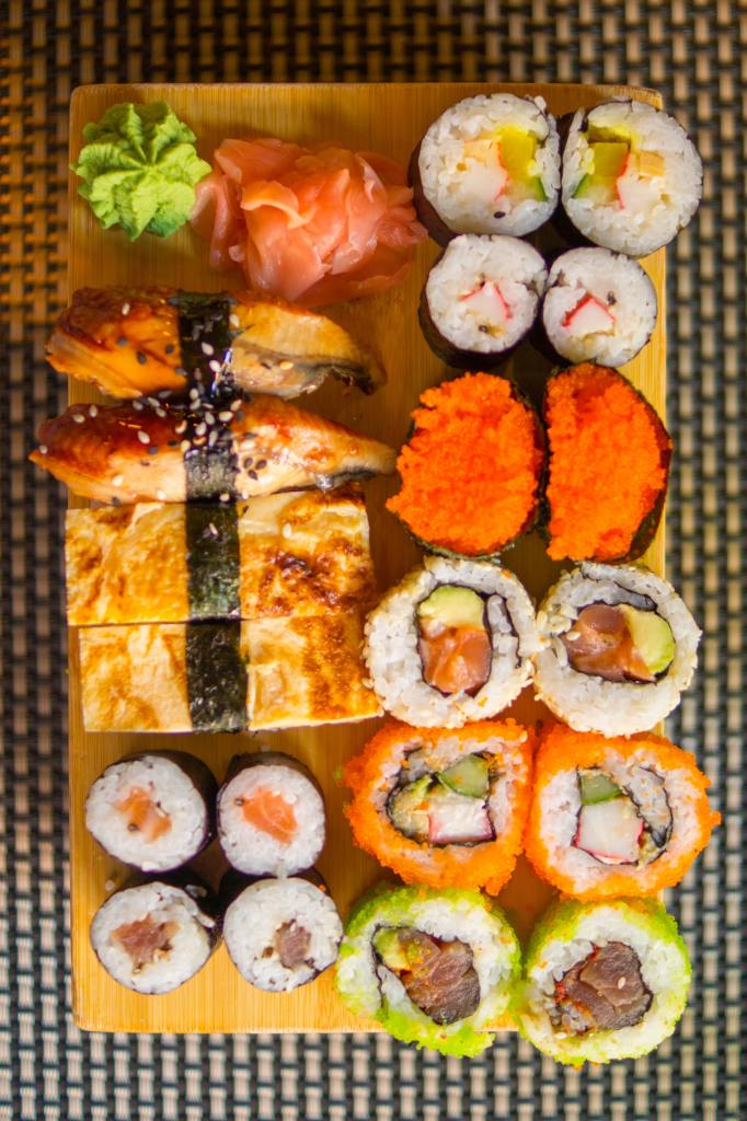 A plate of exquisit sushi sits on a wooden board. Intended to be clicked to provide money to a paypal account.
